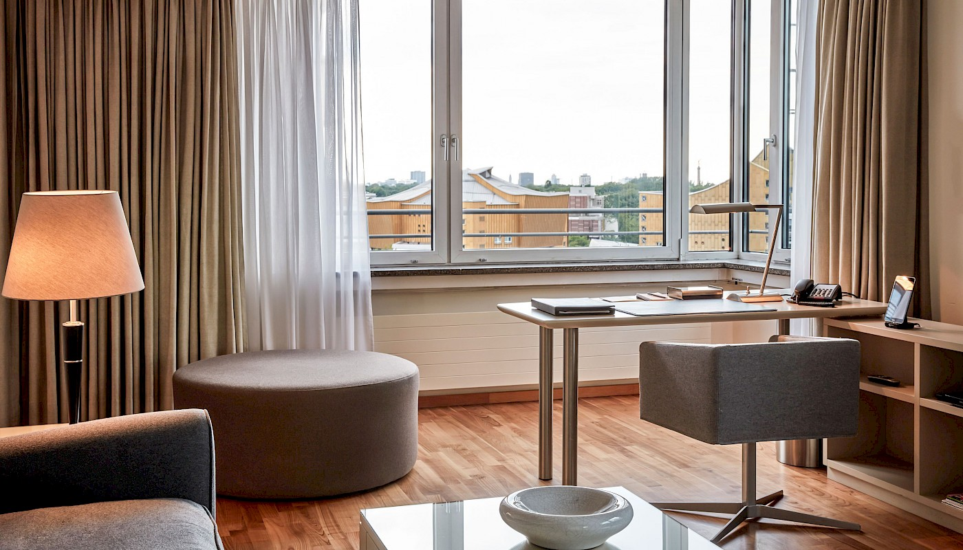 A fantastic view of the Philharmonie and the Tiergarten is available in this Executive Suite at THE MANDALA HOTEL