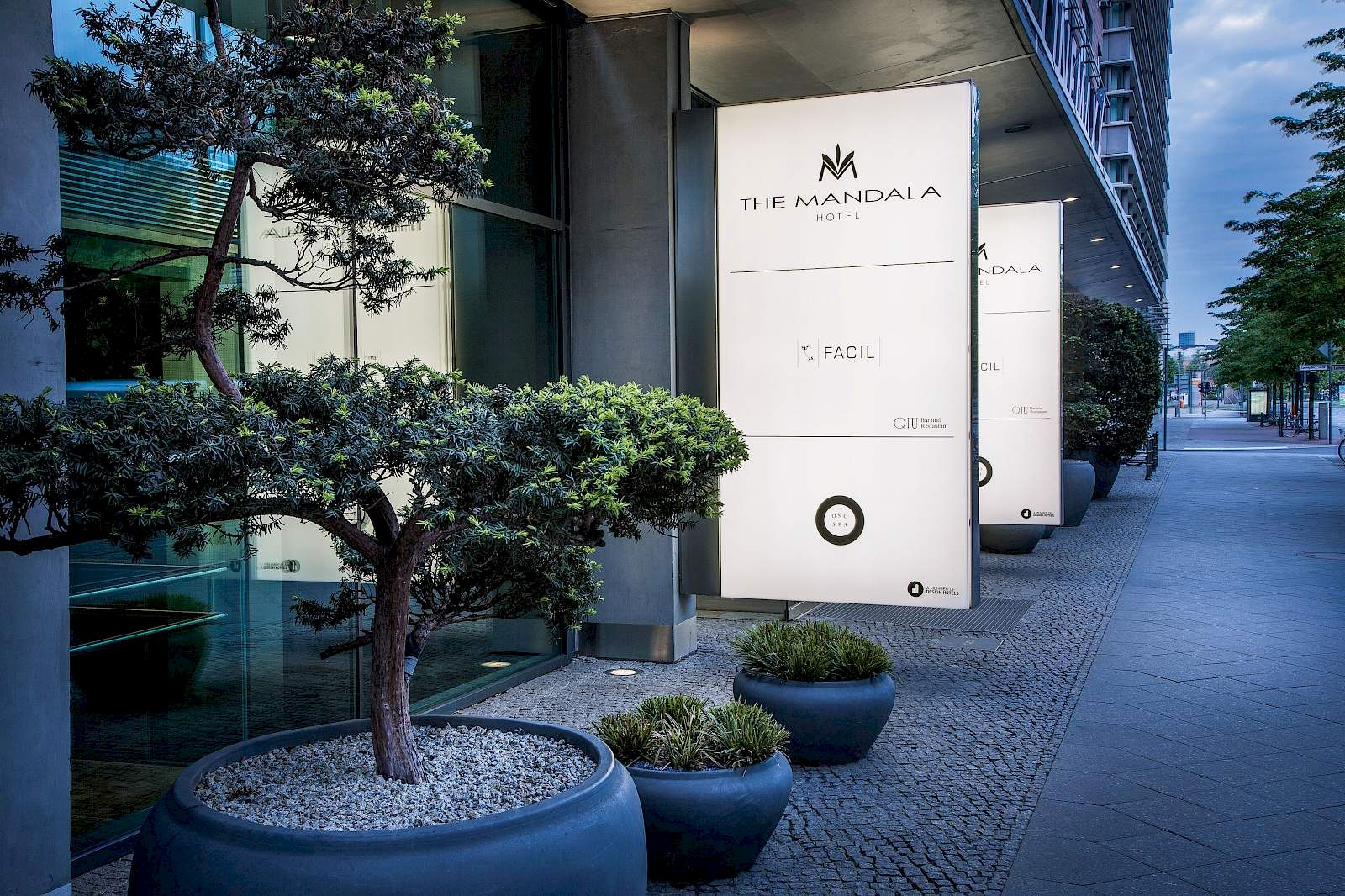 The stylish entrance of THE MANDALA HOTEL in Berlin